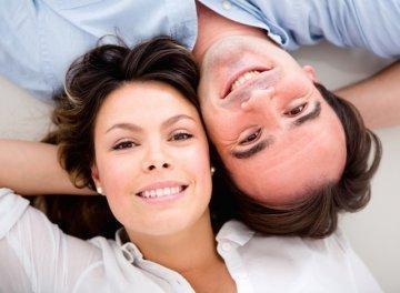 Man and wife laying down | Dental Crowns Edmond OK