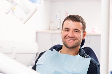 Man smiling at dental exam | Root Canals in Edmond OK