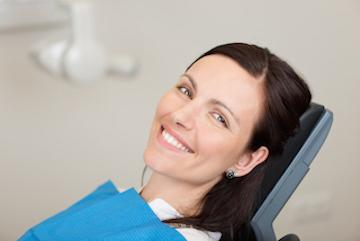 Woman smiling at a dental exam in Edmond, OK